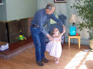 Dad dancing with a granddaughter