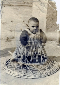 1950s: Baby called Jesús Ballesteros learning to walk with a wicker frame www.retronaut.com