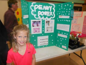 My best gal - who loves art so much that the Science Fair project was not complete without polka-dots and a flower border.