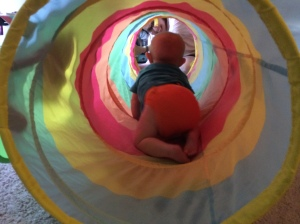 Remy crawls through rainbow tunnel