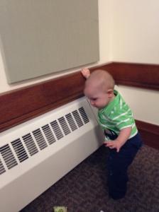 baby explores classroom